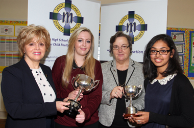 School Principal Mrs Sheila Darling and Sister Deirdre Mullan, Director of the UN's Mercy Global Concern,  with prize winners Chantelle Grieve with the Millenium Salver and Merin Antoney, Best Overall GSCE student with the McAuley Cup.
