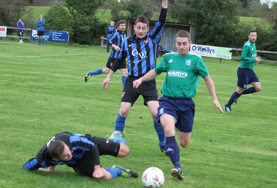 Downpatrick's Stephen Galbraith puts the UUJ defence under pressure.