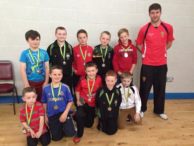 The U-10 prize winners with Down player Peter Turley.