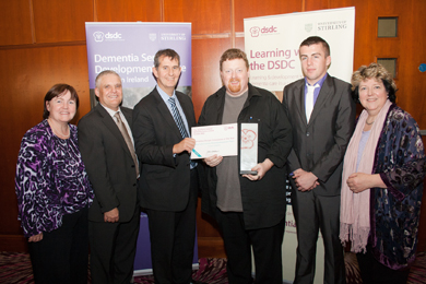 Barry Lynch and the Downe dementia Assessment team are presented with an award from Health MInister Poots.