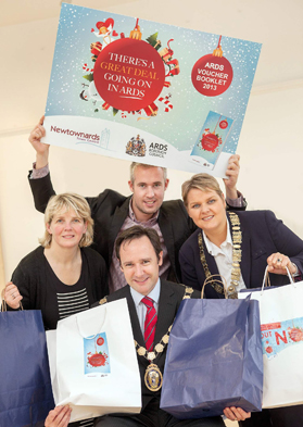 Promoting the Christmas discount shopping booklet produced for Newtownards are: (L-R) Heather Lavery, Sheldon Galleries, Chris Tedford, Molly Brown's, Mayor of Ards, Councillor Stephen McIlveen and Leigh Nelson, Specsavers and President of the Chamber of Trade.