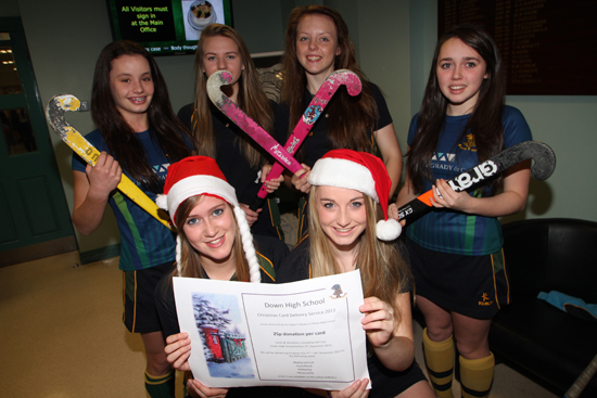 Looking forward to delivering Christmas cards tio raise funds for the Down High School hickey club are fron row, Hannah Beattie and Erin Gabbie with back row, Ellen Erskine, Rasalyn Magee, Brittany Hogan and Julie-Anne Scott.
