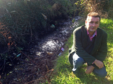 Councillor Willie Clarke checks out the litter and watercourses near the Islands Car Park in Newcastle.