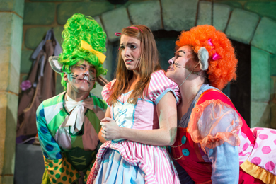 Cinders: Naomi Rocke as Cinderella with Tommy Wallace (left) and Orla Mullan (right) in a scene from Cinderella at the Lyric Theatre until 5 January. (Photo by Steffan Hill)