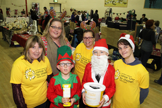 Marion Lennon, Marianne O'Shea, Kelly Lennon and Sinead Burke assisted by Santa's little helpers Jack and Gavin O'Shea puctured at the fundraising craft fair in Ardglass Community Centre in aid of the Northern Ireland Cancer Fund for Children.