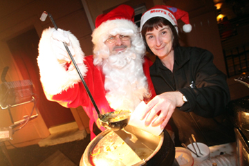 Santa at a soup stall outside AJ's Dinner with helper Patricia Mallon.