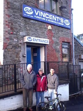 Shedders Barney and Rodney McKeown are pictured donating an old bicycle which they had repaired to Gareth Baggley from St Vincent de Paul Society in Downpatrick.