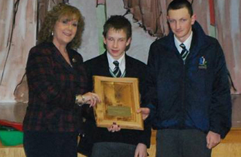 Dr Olywn Griffith, principal of Blackwater Integrated College, honours    by presenting the Downpatrick Lions Shield.