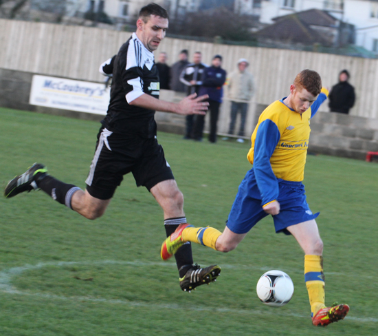 Drumaness Mills forward McIlmurray scores the only goal of the match against Crumlin Star.