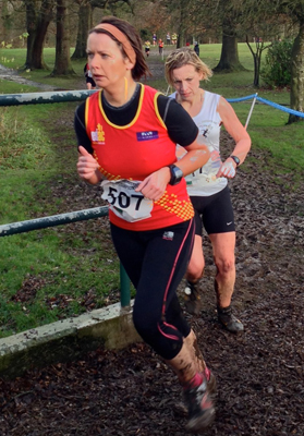 Tracey McDowell heads for the finishing line through the mud.
