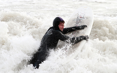 Mark Lappin battles his way through the surf at Coney Island.