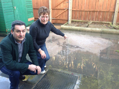 Councillor Wilie Clarke with Newcastle resident Donna Feenan who experiences flooding problems in her back yard.