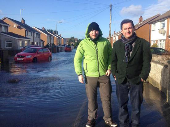 South Down MLA Chris Hazzard with Councillor Willie Clarke looking over the flooding problem in Newcastle on Sunday.