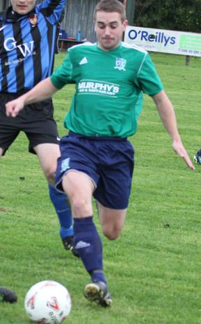 Downpatrick's Stephen Galbraith puts the UUJ defence under pressure.