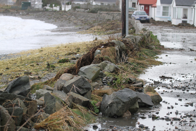 A heavy stone wall was breached by the recent  tidal surge at Coney Island and residents are concerned what lies ahead with future storms.