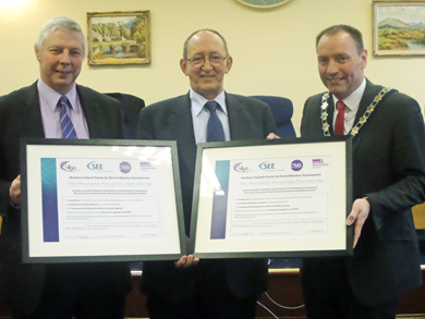 Down District Councillor Robert Burgess and Newry and Mourne Council Councillor show off their Charter Certficates from NILGA.