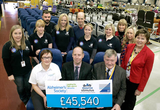 Checking out: Presenting a massive employee donation of £45,540, to be shared between Alzheimer's Society and Mourne Stimulus Day Centre are (front row, from left) Gillian Clarke from Alzheimer's Society; Martin McGinley, Vice President and Managing Director of B/E Aerospace and Dan Cunningham and Eleanor Wilson from Mourne Stimulus with Social & Charity Committee members,  (back row, from left) Helen Pullins, Francine Hanna, Paul McArdle, Adele Scott, William Wilson, Breige Leddy,Laura McBride, Wendy Graham, Heather Magowan.