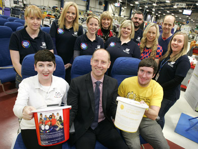 New charity partners for 2014 – Julie Smith from Happy Faces NI and Matthew Allen from Northern Ireland Cancer Fund for Children meet (front) Martin McGinley, Vice President and Managing Director of B/E Aerospace Kilkeel and, back row, from left, Francine Hanna, Adele Scott, Breige Leddy,Wendy Graham, Laura McBride, Paul McArdle, Heather Magowan, William Wilson & Helen Pullins.