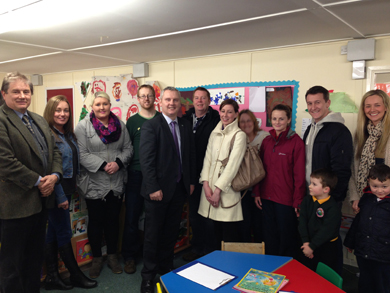 Cllr Cadogan Enright, left, with John McCallister MLA, fifth left, and supporters of the campaign at the Millfield Irish speaking playschool in Killough.
