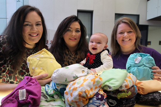 Crossgar mum Ciara Mullan, centre, with her ten-week old baby Maya all smiles pictured with Down District Council Chairman Cllr Marie McCarthy and Siobhan Grant of Cloth Nappy Library NI.