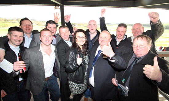 Downpatrick FC management and sponsors at the Downpatrick Race Meeting waiting for the Ulster National.
