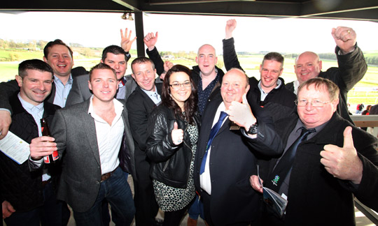 Downpatrick FC management, committee and sponsors in celebratory mood at the Downpatrick Race Meeting waiting for the Ulster National.