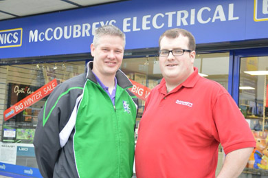 Shane of Downpatrick FC with sponsor McCoubrey's Electrical,