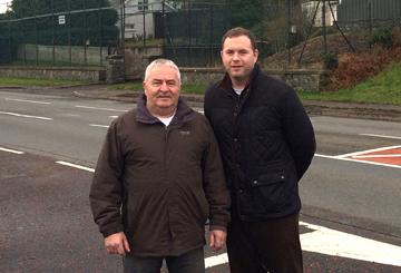 Rowallene Sinn Féin candidate Eddiie Hughes and South Down MLA Chris Hazzard look over housing need in Crossgar.