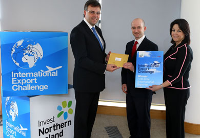 Alastair Hamilton, Invest NI Chief Executive, and Brenda Morgan of British Airways, pictured with Cahir King of Treidliacht Ltd from Downpatrick, centre,  who were successful in winning the exporter support package.