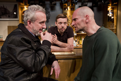 Jimmy and Ian played by Declan Conlon and Patrick O'Kane square up at the Lyric in a scene from Quietly by Owen McCafferty. The Abbey Theatre play about reconciliation tours during an historic week for British-Irish relations. (photo by Brian Morrison).