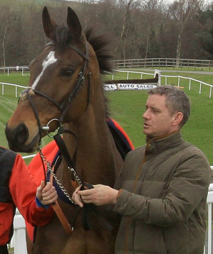 Warne was a winner at Aintree pictured with  Downpatrick trainer Brian Hamilton.