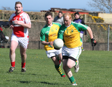 Ardglass defender Malachy Crangle makes an attack on the St Michael's goa.
