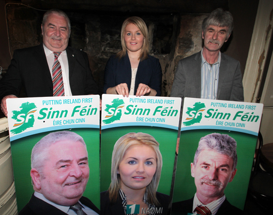 Eddie Hughes, right, has condemned the removal of Sinn FŽin election posters in Ballynahinch. Included are Downpatrick area condidates Naomi Bailie and Eamonn Mac Con Midhe.