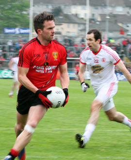 Down player Mark Poland eyes the Tyrone crossbars.