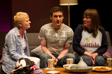 Carol Moore as mum Dorothy, Declan Rodgers as Stevie and Abigail McGibbon as sister Rebecca in a scene from from comedy romance Can't Forget About You in the Lyric Theatre from12 June to 5 July(Photo by Steffan Hill).