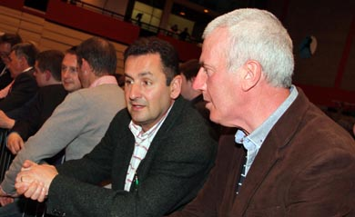 Sinn FŽin Councillors Willie Clarke and Sean Doran look on as the count progresses in the Newry Sports Centre.