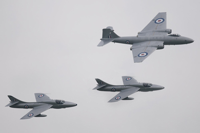 Midair Squadron's Canberra PR9 is welcomed to home turf at Newcastle Festival of Flight, Northern Ireland, flanked by both Hunter T7's.