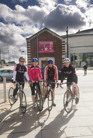 NI Water cyclists, including Portaferry woman Fiona Duff (second from left), at the Oxford Street wastewater pumping station.  (Photo by Brian Morrison.)