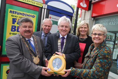 Councillor Billy Walker, Down District Council Chairman, Gareth McWilliams, BT General Manager, Brendan Kearney, Downpatrick Lions Chairman, Paula Powell, Red Cross , and South Down MP Maragert Ritchie at the official launch of the Downpatrick Market Street defribrillator kiosk.