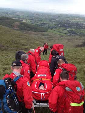 The MMRT bring down the injured walker to safety off Slievenabrock.