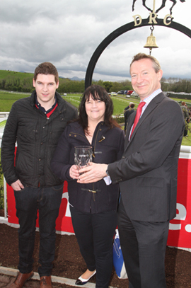 Tim Higgins, CEO of thetote.com, presents a trophy at the May meeting to the winners of the Tote Betting Now Available At Downpatrick Handicap Hurdle, Margaret and Feidhlim Cunnginham with Royal Chief ridden by Michael Butler.