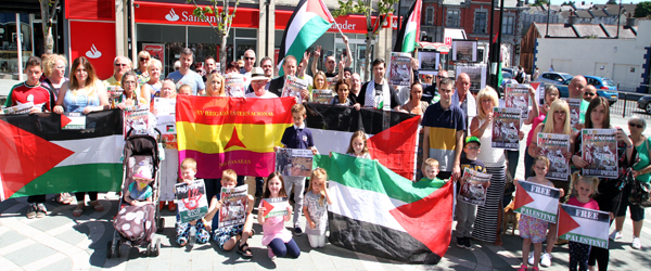 Protesters take to Market Street in Downpatrick to call for an end to the Israeli siege of Gaza in Palestine.