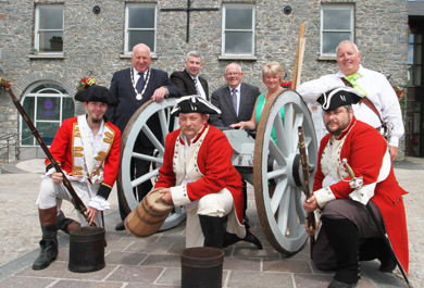Historical re-enactors brought drama and a sense of heritage to the launch of the new Ballynahinch Harvest & Country Living Festival. Behind the guns and behind the event are, from left, Deputy Chair, Councillor Des Patterson; Councillor Walter Lyons, Councillor Patrick Toman and Councillor Anne Marie McAleenan.