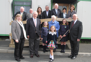 Janice Marshall, front left, with Baroness May Blood MBE, school pupils Charlotte Kerr, Alice Poots and Phoebe Poots  and members of the Drumlins IPS board and representatives from the Amercan Fund
