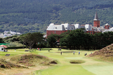A relaxed scene at Royal County Down with the Slieve Donard Hotel and Spa in the background and the Mountains of Mourne.