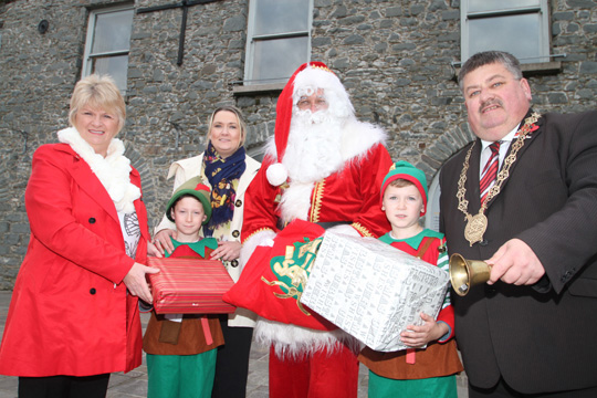 At the launch of the Ballynahinch Christmas Lights were Cllr Anne McAleenan, Natasha Smyth, Down District Council Economic Development Officer, Santa Claus, and Council Chairman Cllr Billy Walker with Santa's elves, twins  Ethan and Eoin Smyth.