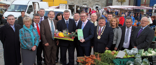 DSD Minister Mervyn Storey launches the Ballynahinch Masterplan outside the Market House.