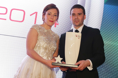 David Healy with his Hall of Fame Award presented by Joanne Hayden, Sales and Marketing Manager of  Linwoods, sponsor of the Belfast Telegraph Sports Awards 2014.