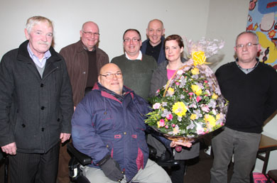 Leas Curran, Development Officer with the County Down Rural Community Network, receives a bouquet for flowers from Joe McVeigh, Crossgar Area CommunityAssociation member at the AGM.