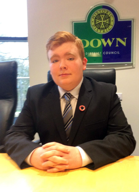 James Savage sitting in the hot seat in the Mourne Room at Down District Council during his recent work experience with the Council Chairman, Cllr Billy Walker.